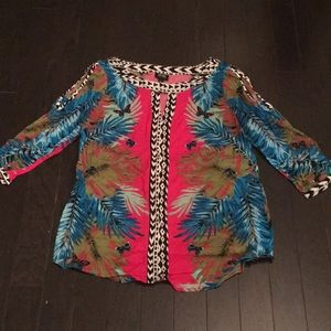 Top with slits in the top of the sleeves